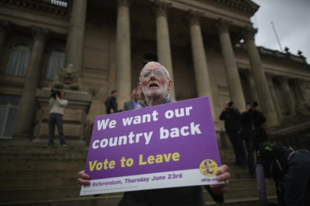 534163756-vote-to-leave-campaigner-holds-a-placard-as-leader-of.jpg.CROP.cq5dam_web_1280_1280_jpeg
